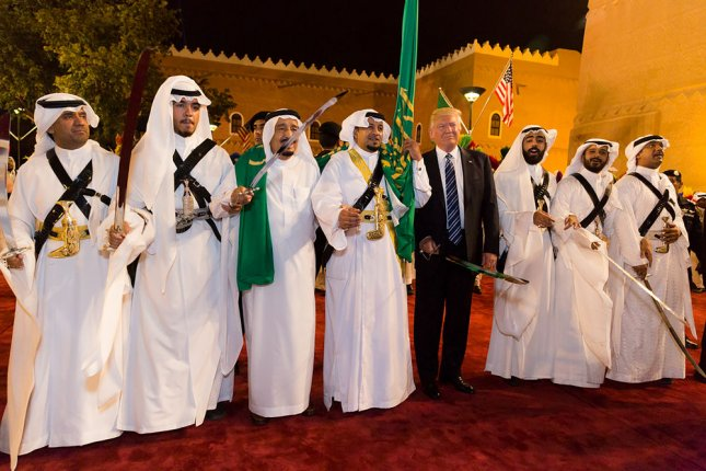 President Donald Trump poses for photos with ceremonial swordsmen on his arrival to Murabba Palace, as the guest of King Salman bin Abdulaziz Al Saud of Saudi Arabia, on May 20 in Riyadh, Saudi Arabia. This week, the Saudi government carried out its 100th execution this year, drawing criticism from human rights groups. File White House Photo by Shealah Craighead/UPI