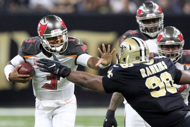 Tampa Bay Buccaneers quarterback Jameis Winston (3) scrambles up the middle for three yards before New Orleans Saints defensive tackle Sheldon Rankins (98) can make the stop midway through the fourth quarter on December 24, 2016 at the Mercedes-Benz Superdome in New Orleans. File photo by AJ Sisco/UPI