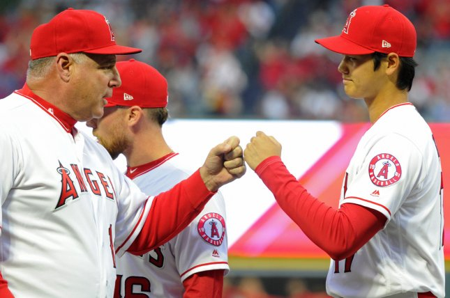 Los Angeles Angels pitcher Shohei Ohtani and manager Mike Scioscia touch fists during introductions before a game against the Cleveland Indians on April 2 at Angel Stadium in Anaheim, Calif. Photo by Lori Shepler/UPI