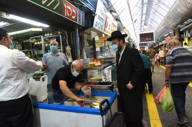 Israelis shop for Rosh Hashana, the Jewish New Year, in the Mahane Yehuda Market in Jerusalem  on Friday. New lockdown restrictions will be in effect for the next three weeks. Photo by Debbie Hill/UPI