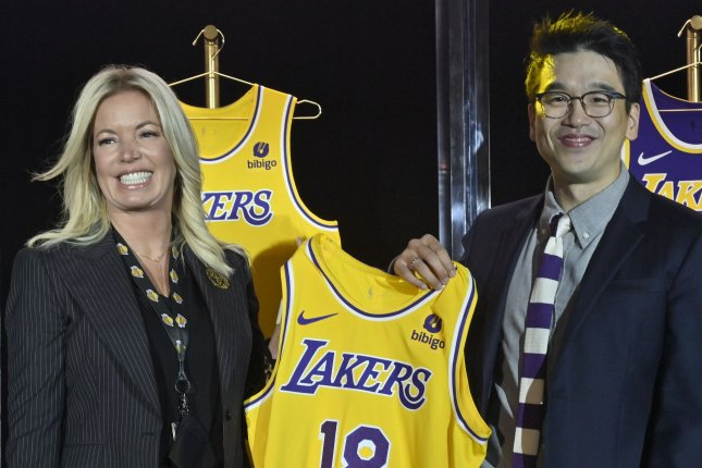 Lakers CEO Jeanie Buss holds a jersey with Bibigo Head of Global Business Planning Sun-Ho Lee Monday during a kick-off event toannounce a new global marketing partnership the South Korean food company, at the UCLA Health Training Center in El Segundo, Calif. Photo by Jim Ruymen/UPI