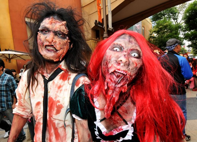 People dress up in their favorite costumes as they participate in a Halloween parade in Kawasaki, Kanagawa-prefecture, Japan, on October 30, 2011. About 3500 people dressed in costumes take part in the ceremony to celebrate Halloween. UPI/Keizo Mori