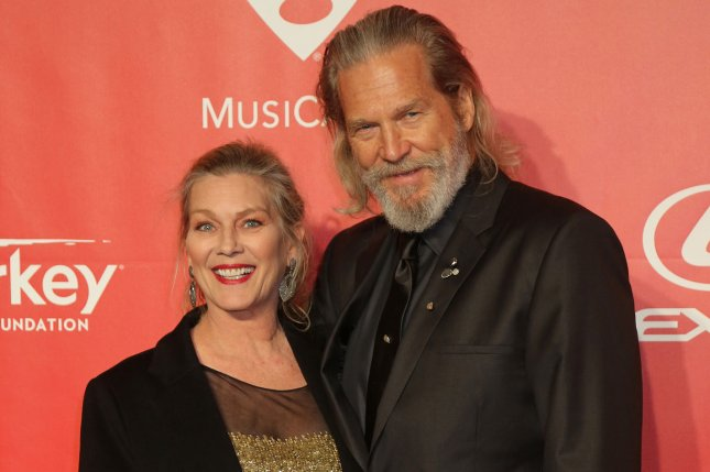 Jeff Bridges (R) and Susan Geston attend the MusiCares Person of the Year gala honoring singer and songwriter Bob Dylan at the Los Angeles Convention Center on February 6, 2015. File Photo by David Silpa/UPI