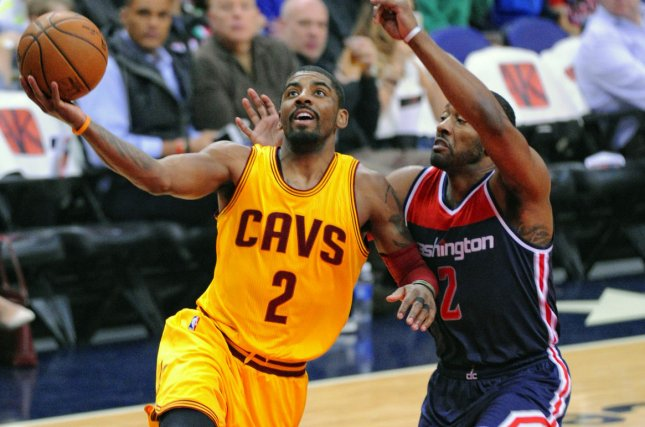 Cleveland Cavaliers guard Kyrie Irving (2) scores against Washington Wizards guard John Wall (2) in the first half at the Verizon Center in Washington, D.C. on February 28, 2016. Photo by Mark Goldman/UPI