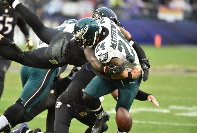 Philadelphia Eagles running back Ryan Mathews (24) drops the ball during a flying stop by Baltimore Ravens defensive back Jerraud Powers (L) during the first half of their NFL game at M&T Bank Stadium in Baltimore, Maryland, December 18, 2016. Photo by David Tulis/UPI