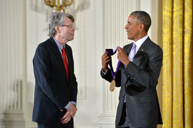 President Barack Obama awards a 2014 National Medal of Arts to author Stephen King during a ceremony at the White House in Washington, D.C. on September 10, 2015. File Photo by Kevin Dietsch/UPI