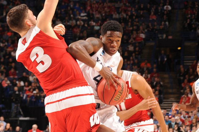 Xavier guard Edmond Sumner tries to drive by Wisconsin's Zak Showalter during the second half in the NCAA Division 1 Men's Basketball Championship at the Scottrade Center in St. Louis on March 20, 2016. Wisconsin defeated Xavier, 66-63. Photo by Doug Devoe/UPI