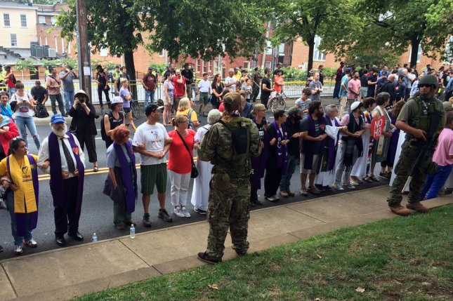 Militia members face off against counter-protesters in Charlottesville, Va. on Saturday. Photo by Virginia State Police/UPI | License Photo
