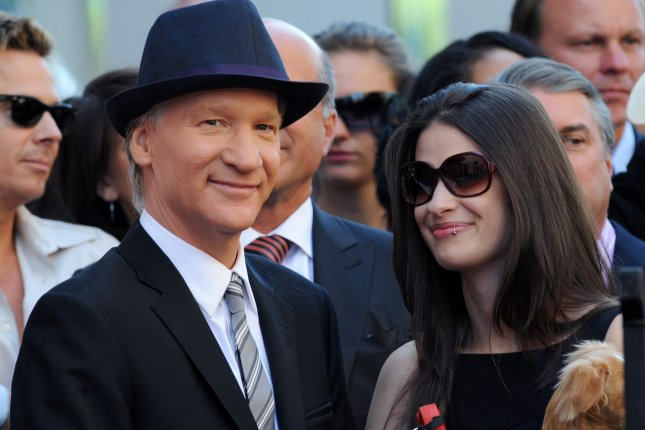 Comedian and television host Bill Maher (L) and girlfriend Cara Santa Maria, holding dog Killer, share a light moment during an unveiling ceremony honoring him with the 2,417th star on the Hollywood Walk of Fame in Los Angeles on September 14, 2010. Maher's Real Time has been renewed through 2020. File Photo by Jim Ruymen/UPI