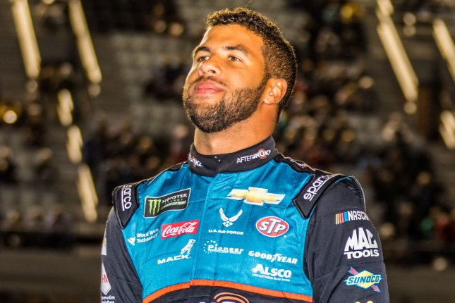 NASCAR drivers showed support by pushing the car of Bubba Wallace, the only black driver in NASCAR's Cup Series, to the top spot in the grid at Talladega Superspeedway after a noose was found in his garage bay on Sunday. File Photo by Edwin Locke/UPI