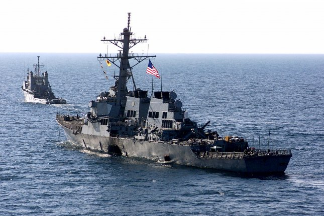 The U.S. Navy destroyer USS Cole is towed away from the port city of Aden, Yemen, into open sea by the Military Sealift Command ocean-going tug USNS Catawba. On October 12, 2000, 17 sailors were killed and 39 injured in an explosion on the USS Cole as it refueled in Yemen. File Photo by Don L. Maes/U.S. Navy