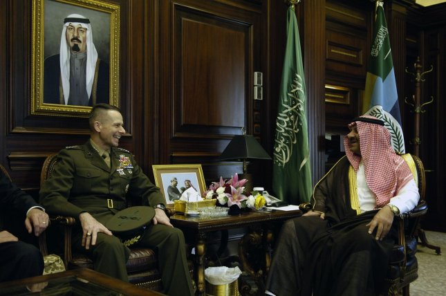 Chairman of the Joint Chiefs of Staff Marine Gen. Peter Pace (L) and Prince Khalid bin-Sultan bin Abdul Aziz Al-Saud, the Saudi Arabian assistant minister of defense and aviation, in Riyadh, Saudi Arabia, March 22, 2006. (UPI Photo/Sgt. D. Myles Cullen/DOD)