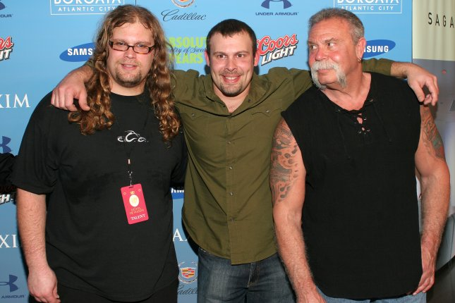 Mikey (L), Paul Jr.(c) and Paul Sr. Teutul arrive for the Hotel De Maxim Super Bowl party at the Sagamore Hotel on Miami Beach, on February 2, 2007. (UPI Photo/Martin Fried)