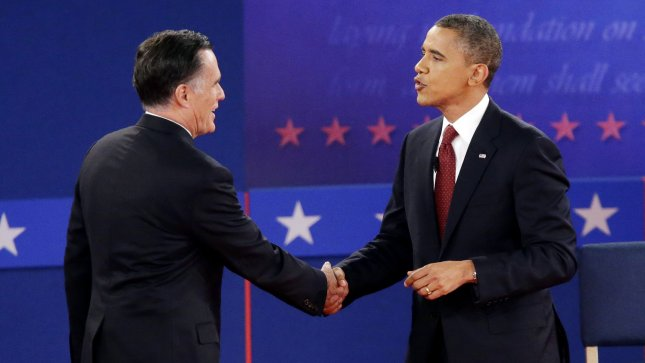 President Obama (R) picked up support to tie Republican rival Mitt Romney going into the final debate, a United Press International poll released Tuesday indicated. Oct. 16 file photo. UPI/John Angelillo