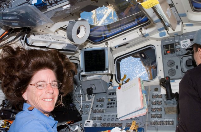 A NASA photo shows teacher/astronaut Barbara R. Morgan on the Space Shuttle Endeavor as it is docked with the International Space Station on August 12, 2007. Morgan transformed the space shuttle and space station into a classroom on August 14 for her first education session from orbit, fulfilling the legacy of Christa McAuliffe, the first teacher/astronaut who was aboard the doomed 1986 Challenger flight. (UPI Photo/NASA/FILES)