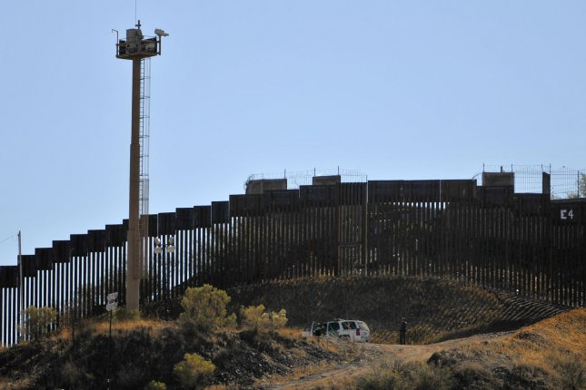 A United States Border Patrol truck sits near the fence along the border between the United States and Mexico in Nogalas, Ariz., December 15, 2011. UPI /Art Foxall