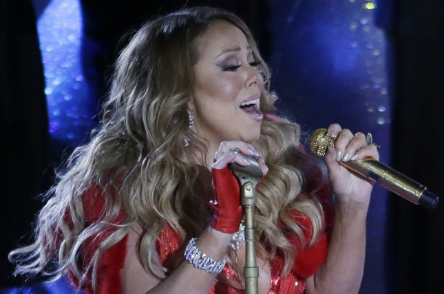 mariah carey performs in rockefeller center at the annual christmas tree lighting ceremony in new york city on december 3 2014