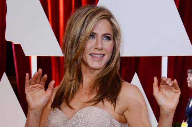 Jennifer Aniston at the Academy Awards on Feb. 22. The actress was spotted in a towel on the 'Mother's Day' set Monday. File photo by Jim Ruymen/UPI