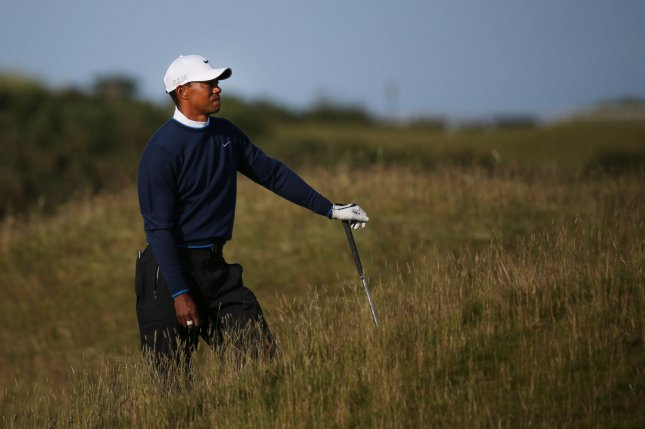 American Tiger Woods stands in the rough on the 16th hole during his delayed second round at the 144th Open Championship, St. Andrews on July 18, 2015.Tiger Woods ended his round with a score of + 7 and missed the cut for the final two days. Photo by Hugo Philpott/UPI