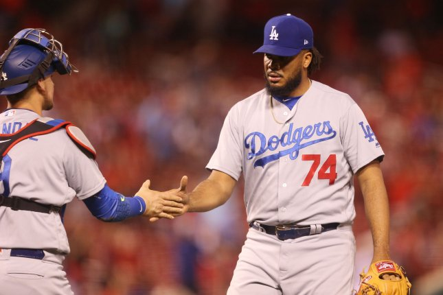 Los Angeles Dodgers pitcher Kenley Jansen and catcher Yasmani Grandal shake hands after the third out and a win. File photo by Bill Greenblatt/UPI