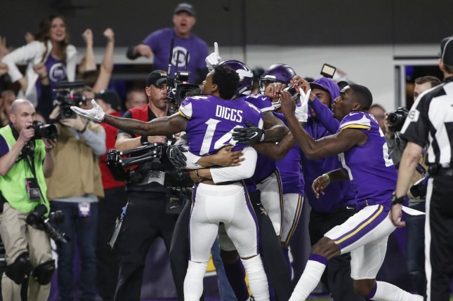 Minnesota Vikings wide receiver Stefon Diggs (14) celebrates with teammates after scoring the game winning touchdown against the New Orleans Saints in the second half of the NFC Divisional round playoff game at U.S. Bank Stadium in Minneapolis on Sunday. The Vikings defeated the Saints 29-24 to advance to NFC Championship game. Photo by Kamil Krzaczynski/UPI