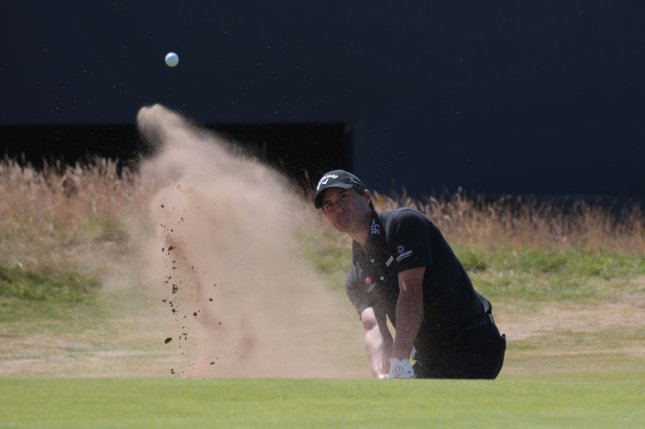 American Kevin Kisner hits out of the bunker on the 18th green on the first day of the 2018 Open Golf Championships on Thursday in Carnoustie, Scotland. Photo by Hugo Philpott/UPI