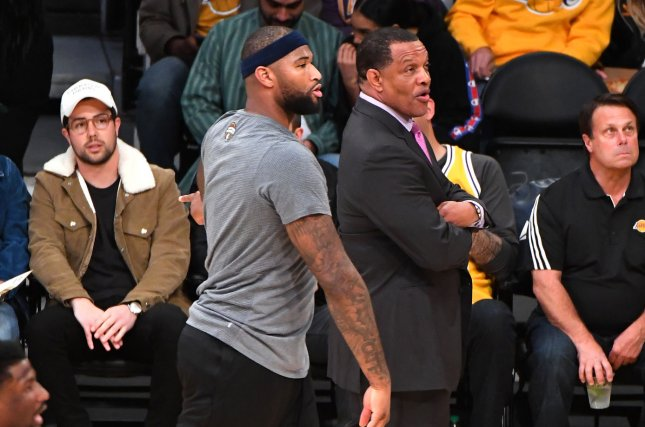 Golden State Warriors center DeMarcus Cousins (left of center) will not be able to take the court Tuesday night against the Timberwolves because of a right ankle injury. File Photo by Jon SooHoo/UPI