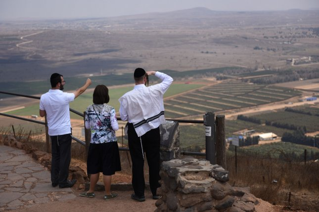 Israelis observe the Israeli-Syrian border from Mount Bental, overlooking the Golan Heights, in August 2015. File Photo by Debbie Hill/UPI