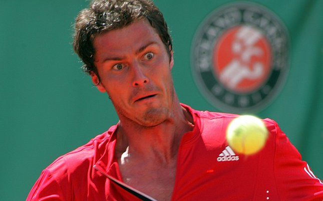 Unseeded former top-ranked tennis star Marat Safin ousted No. 3-seeded Novak Djokovic Wednesday in second-round action at Wimbledon. (File photo of Safin at the French Open tennis tournament in Paris, May 28.) (UPI Photo/Eco Clement)