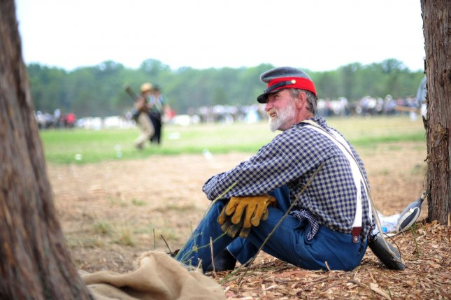 A Civil War reenactor watches the reenactment of the Battle of Bull Run at Brawner Farm in Manassas, Virginia on July 24, 2011. UPI/Kevin Dietsch