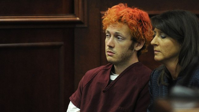 Accused movie theater shooter James Holmes (left) makes his first court appearance at the Arapahoe County Courthouse with his public defender Tamara Brady on July 23, 2012 in Centennial, Colorado. According to police, Holmes committed one of the worst mass shootings in American history, killing 12 people and injuring 58 when he opened fire on a movie theater showing the premier of 'The Dark Knight Rises'. UPI/RJ Sangosti/Pool