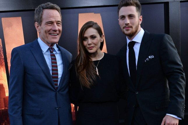 Cast members Bryan Cranston, Elizabeth Olsen, and Aaron Taylor-Johnson attend the premiere of the sci-fi motion picture Godzilla at the Dolby Theatre in the Hollywood section of Los Angeles on May 8, 2014. Storyline: The world's most famous monster is pitted against malevolent creatures who, bolstered by humanity's scientific arrogance, threaten our very existence. UPI/Jim Ruymen