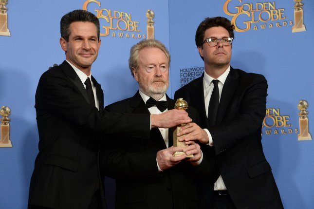 Ridley Scott (C) with Simon Kinberg (L) and Michael Schaefer at the Golden Globe Awards on Sunday. The director says Alien: Covenant will be rated R. File Photo by Jim Ruymen/UPI