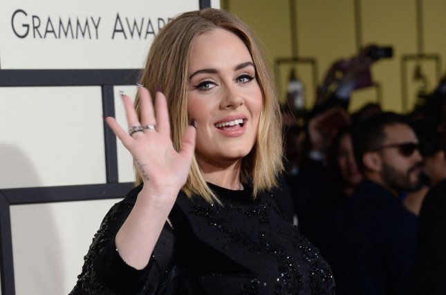 Adele arrives at the 58th annual Grammy Awards at the Staples Center in Los Angeles on February 15, 2016. She paid tribute to Prince in St. Paul. Minn., over the weekend by playing one of his songs on the big video screen. She said she didn't feel worthy to perform a Prince number herself. File photo by Jim Ruymen/UPI
