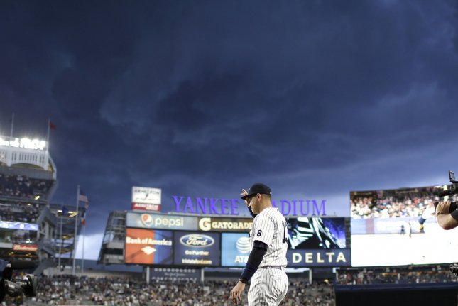New York Yankees Alex Rodriguez grabs his cap as he walks out on to the field for a retirement ceremony in what is to be his final game in the MLB against the Tampa Bay Rays at Yankee Stadium in New York City on August 12, 2016. Alex Rodriguez will end his 22-year playing career with the fourth-most homers in Major League history at 697. Rodriguez will remain in the Yankees organization as an instructor. Photo by John Angelillo/UPI