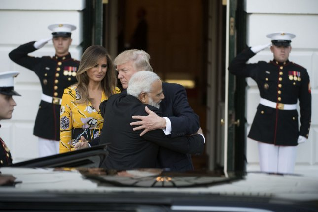 President Donald Trump and Indian Prime Minister Narendra Modi hug as Modi departs the White House on Monday. Photo by Kevin Dietsch/UPI