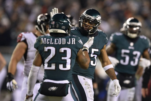 Philadelphia Eagles safety Rodney McLeod (23) celebrates with former linebacker Mychal Kendricks (95) after a sack during the third quarter of the NFC Divisional Round against the Atlanta Falcons on January 13, 2018 at Lincoln Financial Field in Philadelphia. Photo by Derik Hamilton/UPI
