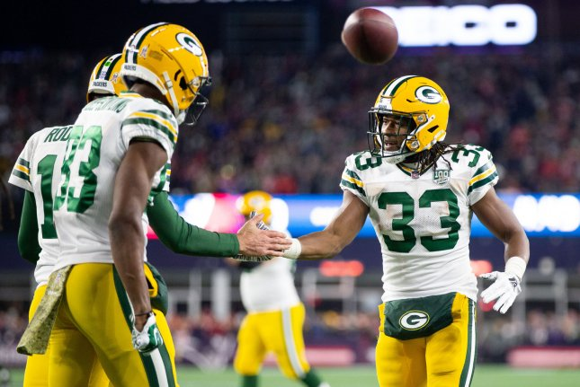 Green Bay Packers running back Aaron Jones (33) gives a high five to quarterback Aaron Rodgers (12) after the Green Bay Packers scored a touchdown against the New England Patriots on November 4, 2018 at Gillette Stadium in Foxborough, Massachusetts. Photo by Matthew Healey/UPI