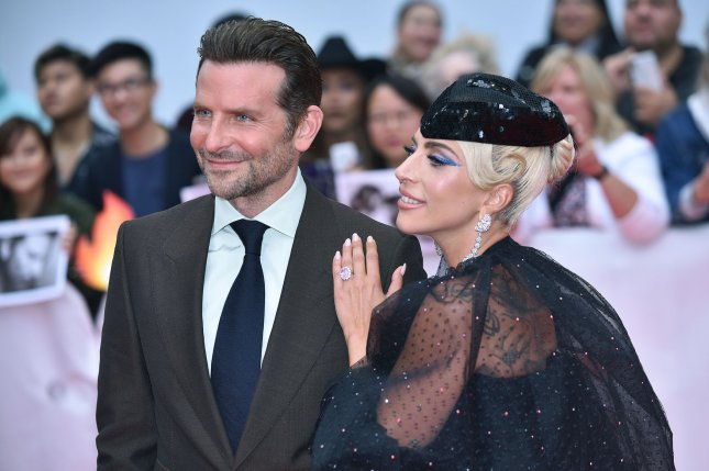 Bradley Cooper (L), pictured with Lady Gaga, hopes to reunite with the singer at an event in the future. File Photo by Christine Chew/UPI