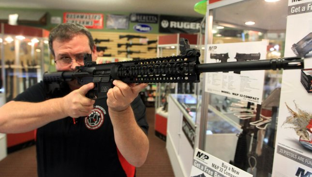 Steven King, owner of Metro Shooting Supplies, shows the proper use of the Smith and Wesson AR-15, 556 caliber rifle November 12, 2014, in Bridgeton, Mo. A federal judge, comparing the rifle to a Swiss Army knife, said a California ban on the firearm was unconstitutional. File Photo by Bill Greenblatt/UPI