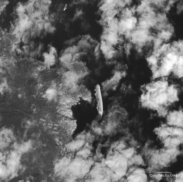 A satellite image captured by Digital Globe of the Costa Concordia, a luxury cruise ship that ran aground in the Tuscan waters off of Giglio, Italy on Friday, January 13, 2012. Eleven people are known dead and more than 20 remain missing. EDITORIAL USE ONLY UPI/Digital Globe/HO