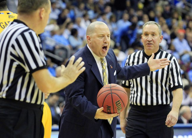 Marquette Golden Eagles head coach Buzz Williams argues with officials in the first half against the North Carolina Tar Heels at the NCAA Final Four East Regional Round of 16 game at the Prudential Center in Newark, New Jersey on March 25, 2011. UPI/John Angelillo