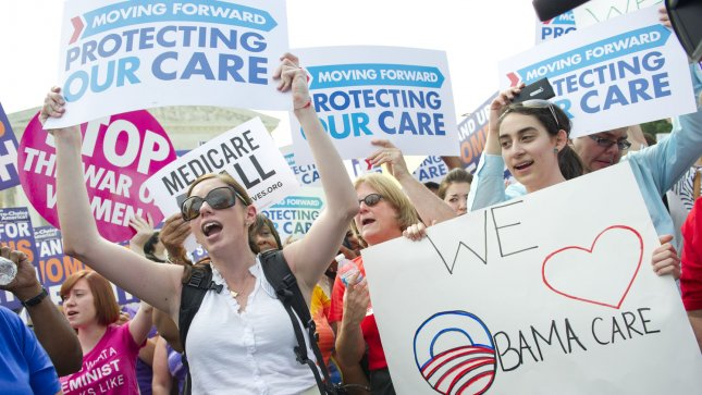 Health care reform supporters cheer after the U.S. Supreme Court upheld a majority of President Obama's health care reform bill, outside of the Supreme Court on June 28, 2012 in Washington, D.C. UPI/Kevin Dietsch