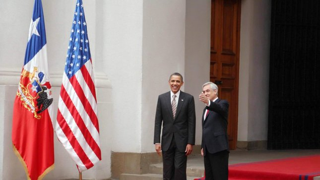 U.S. President Barack Obama is greeted by Chile's President Sebastian Pinera during a welcome ceremony at the Palace of La Moneda in Santiago, Chile on March 21, 2011. UPI/Roberto Baez