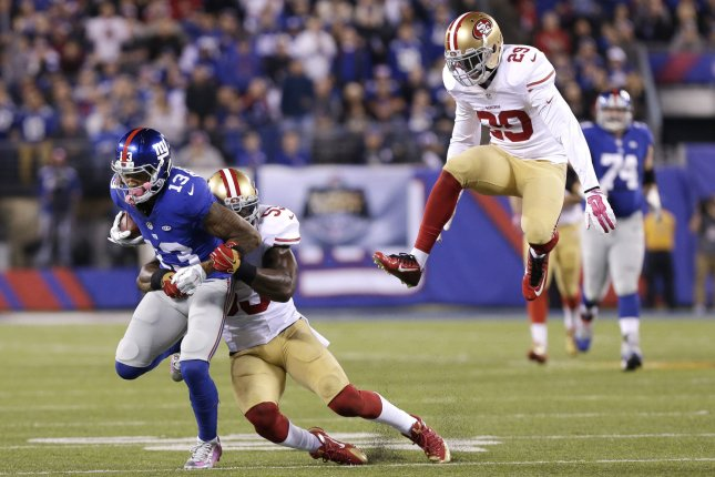 San Francisco 49ERS Jaquiski Tartt leaps while NaVorro Bowman tackles New York Giants Odell Beckham Jr. after in the first half at MetLife Stadium in East Rutherford, New Jersey on October 11, 2015. Photo by John Angelillo/UPI