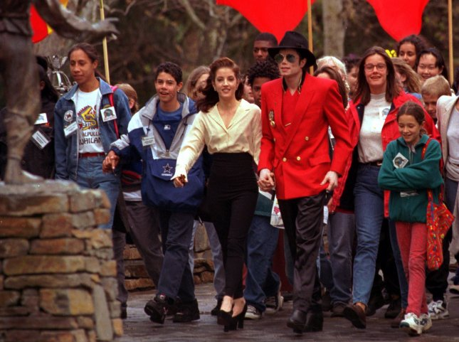 Lisa Marie Presley Jackson filed for divorce January 18, 1996, from the so-called King of Pop Michael Jackson, marking the end of what has been widely seen as one of entertainment's most bizarre marriages. The couple are pictured walking hand-in-hand last April as they hosted youngsters at Jackson's Neverland Ranch in Santa Ynez, California. File Photo by Jim Ruymen/UPI