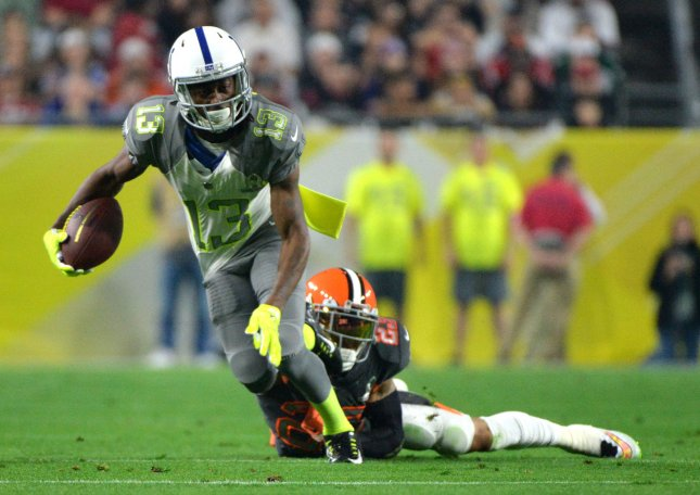Indiana Colts wide receiver T.Y Hilton carries the ball against Cincinnati Browns Joe Haden during the Pro Bowl at University of Phoenix Stadium in Glendale, Arizona on January 24, 2015. Photo byKevin Dietsch/UPI