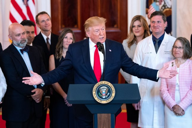 President Donald Trump speaks alongside medical professionals and patients before signing the Improving Price and Quality Transparency in American Healthcare to Put Patients First executive order at the White House on Monday. Photo by Kevin Dietsch/UPI