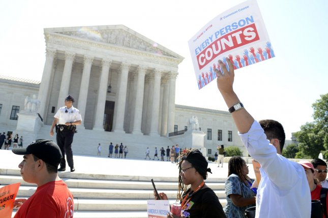 Demonstrators march in front of the Supreme Court in June before its gerrymandering ruling on cases in North Carolina and Maryland. On Monday, the court said federal judges should not step into another case in Michigan. Photo by Mike Theiler/UPI
