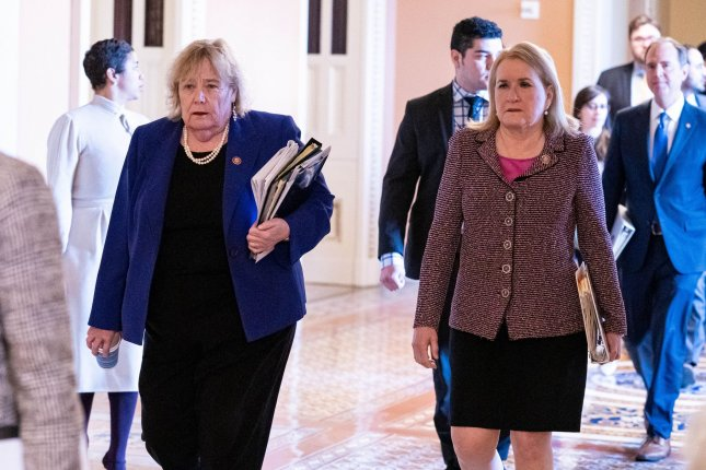 Rep. Zoe Lofgren, D-Calif., (L) and Rep. Sylvia Garcia, D-Texas, walk into the Senate chamber for the impeachment trial of President Donald Trump on Wednesday. Lofgren, a House manager in the trial, has worked in some capacity on all three modern impeachments. Photo by Ken Cedeno/UPI